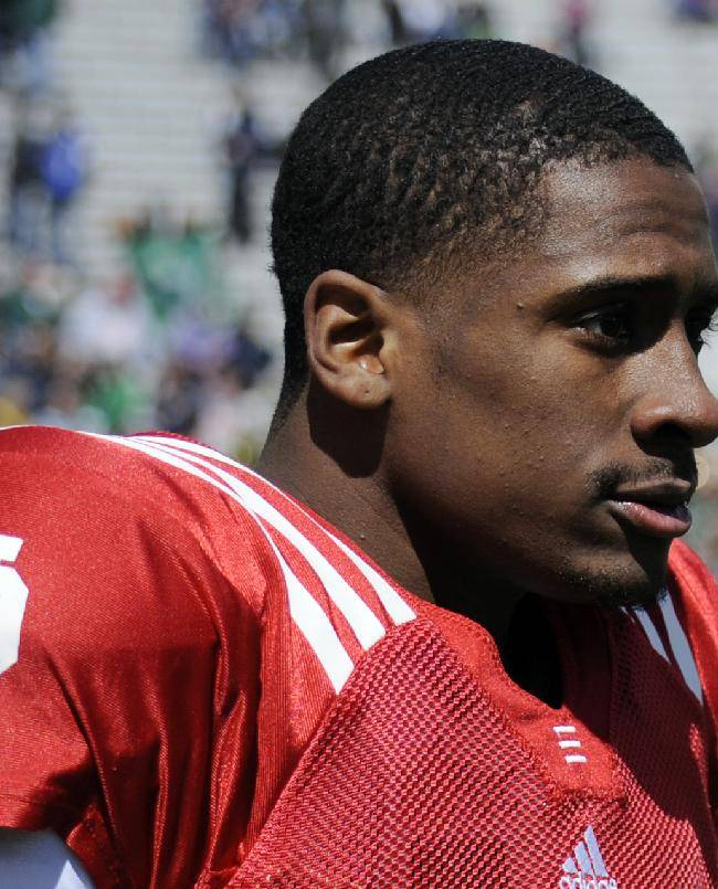 In this April 20, 2013, file photo, Notre Dame quarterback Everett Golson walks off the fieldduring the Blue-Gold spring scrimmage NCAA college football in South Bend, Ind. Golson says he was suspended from the university for the fall semester for using