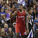 Los Angeles Clippers center DeAndre Jordan, left, pumps his fist after scoring and getting fouled to break a 98-98 tie against the Sacramento Kings during overtime in an NBA basketball game in Sacramento, Calif., Friday, Nov. 29, 2013. Jordan missed his