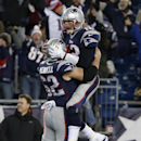 New England Patriots quarterback Tom Brady, right, celebrates his go-ahead touchdown pass with center Ryan Wendell (62) in the fourth quarter of an NFL football game against the Cleveland Browns Sunday, Dec. 8, 2013, in Foxborough, Mass. The Patriots came