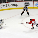Chicago Blackhawks' Marian Hossa (81) scores the game winning goal on Minnesota Wild goalie Ilya Bryzgalov in a shootout during an NHL hockey game in Chicago, Thursday, April 3, 2014. The Blackhawks won 3-2 The Associated Press