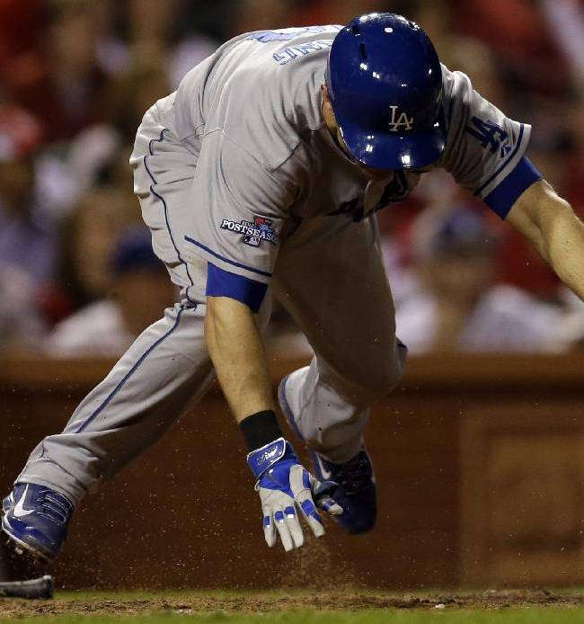 Los Angeles Dodgers' Michael Young trips as he grounds into a double play during the 12th inning of Game 1 of the National League baseball championship series against the St. Louis Cardinals Friday, Oct. 11, 2013, in St. Louis