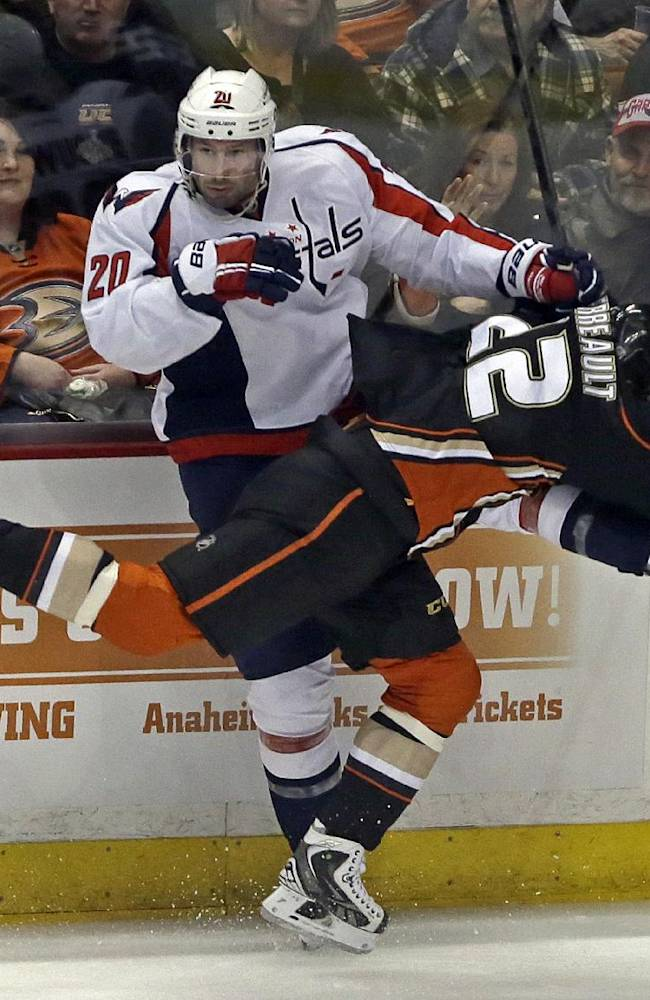 Washington Capitals right winger Troy Brouwer (20) and Anaheim Ducks center Mathieu Perreault (22) tangle in the third period of an NHL hockey game Tuesday, March 18, 2014. The Capitals won, 3-2