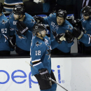 San Jose Sharks' Patrick Marleau (12) celebrates his goal with teammates during the second period of an NHL hockey game against the New York Islanders on Tuesday, Dec. 10, 2013, in San Jose, Calif The Associated Press