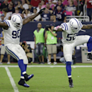 Indianapolis Colts' Cory Redding (90) and D'Qwell Jackson (52) celebrate after they sacked Houston Texans' Ryan Fitzpatrick during the first quarter of an NFL football game, Thursday, Oct. 9, 2014, in Houston The Associated Press