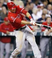 Los Angeles Angels' Mike Trout hits an RBI single against the Seattle Mariners in the fourth inning of a baseball game, Monday, Oct. 1, 2012, in Seattle. (AP Photo/Elaine Thompson)