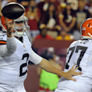 Cleveland Browns quarterback Johnny Manziel (2) throws under the protection of guard John Greco (77) during the first half of an NFL preseason football game against the Washington Redskins, Monday, Aug. 18, 2014, in Landover, Md The Associated Press