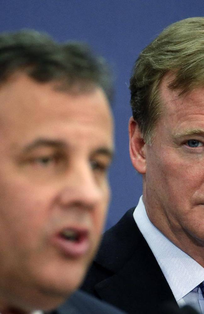 NFL commissioner Roger Goodell, right, listens to New Jersey Gov. Chris Christie speak at an NFL Foundation news conference Monday, Jan 27, 2014, in Newark, N.J