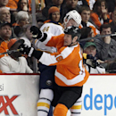 Philadelphia Flyers' Adam Hall, right, checks Buffalo Sabres' Nicholas Deslauriers against the boards during the first period of an NHL hockey game, Sunday, April 6, 2014, in Philadelphia The Associated Press