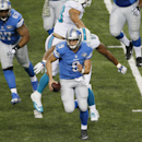 Detroit Lions quarterback Matthew Stafford (9) scrambles away from Miami Dolphins defensive end Cameron Wake during the first half of an NFL football game in Detroit, Sunday, Nov. 9, 2014 The Associated Press