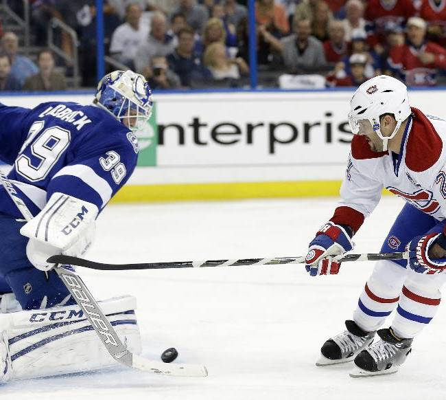 Tampa Bay Lightning goalie Anders Lindback (39), of Sweden, stops a breakaway by Montreal Canadiens right wing Brian Gionta (21) during the first period of Game 2 of a first-round NHL hockey playoff series on Friday, April 18, 2014, in Tampa, Fla