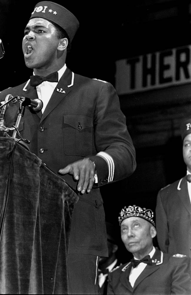 In this Feb. 25, 1968 file photo, former heavyweight boxing champion Muhammad Ali addresses a gathering at a Black Muslim convention in Chicago. Seated behind Ali is Elijah Muhammad, leader of the Nation of Islam. Barely past the opening credits of a new documentary about Ali, we get a glimpse of how many Americans felt about him during a tumultuous time in the country's history