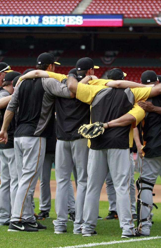 Members of the Pittsburgh Pirates gather on the field at Busch Stadium during a workout on Wednesday, Oct. 2, 2013, in St. Louis. Game 1 of the National League Division Series baseball playoff between the Pirates and the St. Louis Cardinals is scheduled for Thursday