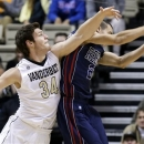 Mississippi guard Marshall Henderson (22) grabs a rebound in front of Vanderbilt forward Shelby Moats (34) in the first half of an NCAA college basketball game on Tuesday, Jan. 15, 2013, in Nashville, Tenn. (AP Photo/Mark Humphrey)