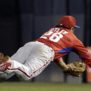Philadelphia Phillies second baseman Chase Utley dives for a single by New York Yankees' Brett Gardner during the third inning of an exhibition baseball game in Tampa, Fla., Tuesday, March 25, 2014 The Associated Press