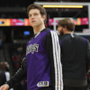Sacramento Kings guard Jimmer Fredette looks on against the Denver Nuggets in the first quarter of an NBA basketball game in Denver on Sunday, Feb. 23, 2014. (AP Photo/David Zalubowski)
