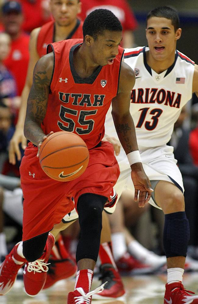 Utah's Delon Wright (55) dribbles the ball past Arizona's Nick Johnson (13) in the first half of an NCAA college basketball game on Sunday, Jan. 26, 2014, in Tucson, Ariz