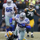 Green Bay Packers free safety Ha Ha Clinton-Dix (21) tackles Dallas Cowboys tight end Jason Witten (82) during the second half of an NFL divisional playoff football game Sunday, Jan. 11, 2015, in Green Bay, Wis The Associated Press