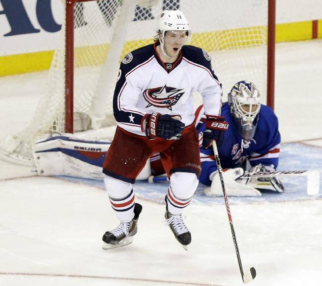 Columbus Blue Jackets center Ryan Johansen (19) celebrates after scoring the game winning goal against New York Rangers goalie Henrik Lundqvist, of Sweden, during the shootout period of an NHL hockey game Monday, Jan. 6, 2014, in New York. The Blue Jackets won the game 4-3 in a shootout