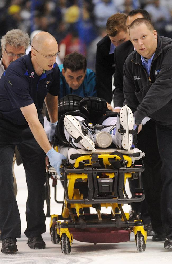 San Jose Sharks' Dan Boyle, on stretcher, is taken from ice during the first period of an NHL hockey game against the St. Louis Blues on Tuesday, Oct. 15, 2013, in St. Louis