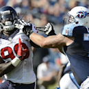 Tennessee Titans offensive tackle Taylor Lewan (77) gets a hand on the hair of Houston Texans linebacker Jadeveon Clowney (90) in the third quarter of an NFL football game, Sunday, Oct. 26, 2014, in Nashville, Tenn. (AP Photo/Mark Zaleski)