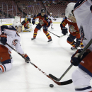 Columbus Blue Jackets left wing Matt Calvert, left, and right wing Jack Skille, right, go for the puck during the first period of an NHL hockey game against the Florida Panthers, Thursday, Dec. 4, 2014, in Sunrise, Fla The Associated Press