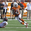 Texas receiver Kendall Sanders (2) runs with a pass against Oklahoma State during the first quarter of an NCAA college football game Saturday, Nov. 16, 2013, in Austin, Texas. (AP Photo/Michael Thomas)