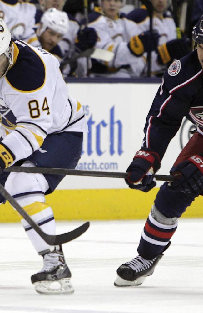 Buffalo Sabres' Philip Varone, left, carries the puck across the blue line as Columbus Blue Jackets' Nathan Horton defends during the third period of an NHL hockey game, Saturday, Jan. 25, 2014, in Columbus, Ohio. The Sabres won 5-2