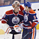 Edmonton Oilers goalie Viktor Fasth (35) and Mark Fayne (5) celebrate a win over the Winnipeg Jets during an NHL hockey game in Edmonton, Alberta, on Monday, Sept. 29, 2014 The Associated Press