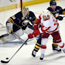 Buffalo Sabres goaltender Michal Neuvirth (34) and defenseman Andre Benoit (61) defend as Detroit Red Wings center Stephen Weiss (90) redirects the puck during the third period of an NHL hockey game Tuesday, Jan. 13, 2015, in Buffalo, N.Y. Detroit won 3-
