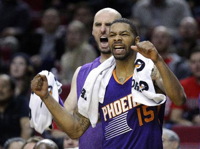 The Phoenix Suns'  Marcus Morris, right, and Marcin Gortat cheer from the bench during the second half of an NBA preseason basketball game against the Portland Trail Blazers in Portland, Ore., Wednesday, Oct. 9, 2013.  The Suns won 104-98