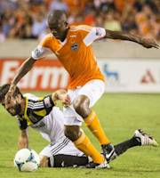 Houston Dynamo midfielder Boniek Garcia, right, is fouled by Columbus Crew defender Agustin Viana, left, during the first half of MLS soccer match on Saturday, Aug. 3, 2013, at BBVA Compass Stadium in Houston. (AP Photo/ Houston Chronicle, Smiley N. Pool)