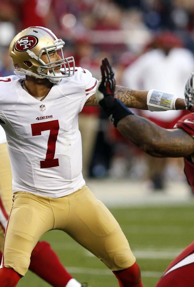 San Francisco 49ers quarterback Colin Kaepernick (7) throws under pressure from Arizona Cardinals defensive end Darnell Dockett (90) during the second half of an NFL football game, Sunday, Dec. 29, 2013, in Glendale, Ariz. The 49ers won 23-20