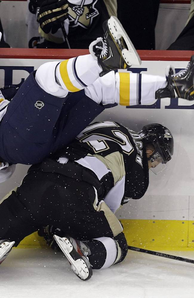 Buffalo Sabres' Steve Ott (9) collides with Pittsburgh Penguins' Chuck Kobasew (12) in the first period of an NHL hockey game in Pittsburgh on Saturday, Oct. 5, 2013