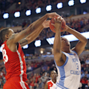 Ohio State center Amir Williams, left, creates a jump ball situation against North Carolina forward Kennedy Meeks (3) during the second half of an NCAA college basketball game, Saturday, Dec. 20, 2014, in Chicago. North Carolina won 82-74. (AP Photo/Charles Rex Arbogast)