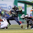 Seattle Seahawks' Marshawn Lynch carries the ball against the Denver Broncos in overtime of an NFL football game, Sunday, Sept. 21, 2014, in Seattle. The Seahawks won 26-20 The Associated Press