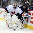 New York Islanders goalie Anders Nilsson (45) squeezes Winnipeg Jets' Blake Wheeler (26) against the boards during the second period of an NHL hockey game in Winnipeg, Manitoba, Tuesday, March 4, 2014 The Associated Press