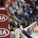 San Antonio Spurs guard Marco Belinelli, from Italy, left, drives on Portland Trail Blazers guard Wesley Matthews during the first half of an NBA basketball game in Portland, Ore., Wednesday, Feb. 19, 2014 The Associated Press