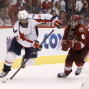 Washington Capitals' Joel Ward (42) skates the puck behind the net as Phoenix Coyotes' David Schlemko (6) defends during the third period of an NHL hockey game, Saturday, Nov. 9, 2013 in Glendale, Ariz The Associated Press