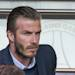 PARIS, FRANCE - MAY 05: David Beckham attends the match between Paris Saint Germain FC and Valenciennes FC at Parc des Princes on May 5, 2013 in Paris, France.  (Photo by Paul Hubble/WireImage)