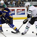 Dallas Stars center Tyler Seguin shoots between the legs of St. Louis Blues left wing Tyler Seguin, left, as he passes off the puck in the second period of a preseason NHL hockey game at the Sprint Center in Kansas City, Mo., Saturday, Sept. 27, 2014. The