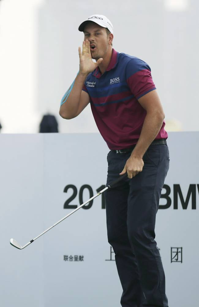 Henrik Stenson of Sweden jokes during a photo call ahead of the Masters golf tournament in Shanghai, China, Tuesday, Oct. 22, 2013.  The Masters will begin on Oct. 24 at the Lake Malaren Golf Club