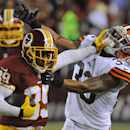 Washington Redskins wide receiver Santana Moss (89) stiff armsCleveland Browns cornerback Jordan Poyer (33) during the first half of an NFL preseason football game Monday, Aug. 18, 2014, in Landover, Md The Associated Press