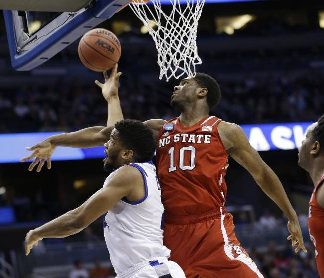 Saint Louis forward Dwayne Evans (21) drives to the basket as North Carolina State forward Lennard Freeman (10) defends during the first half of a second-round game in the NCAA college basketball tournament Thursday, March 20, 2014, in Orlando, Fla. Evans maked the shot