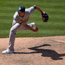 FILE - In this June 14, 2015, file photo, Oakland Athletics relief pitcher Tyler Clippard throws to the plate during the ninth inning of a baseball game against the Los Angeles Angels in Anaheim, Calif. In their second trade in four days, the New York Mets have acquired closer Clippard from the Oakland Athletics for minor league pitcher Casey Meisner. (AP Photo/Mark J. Terrill, File)