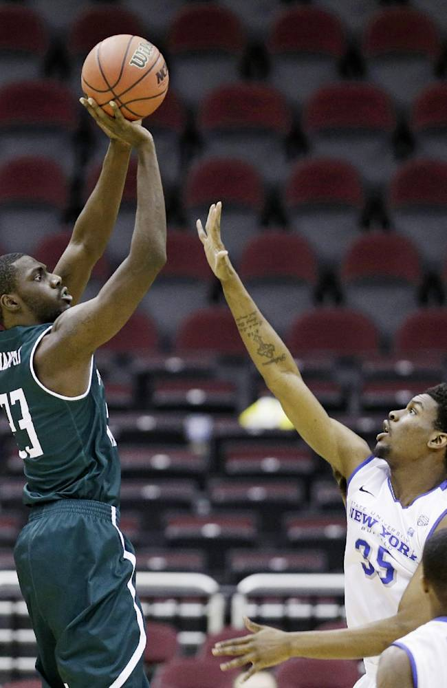 Eastern Michigan's Glenn Bryant, left, shoots over Buffalo's Xavier Ford during the second half of an NCAA college basketball game at the Mid-American Conference tournament Thursday, March 13, 2014, in Cleveland. Eastern Michigan defeated Buffalo 69-64