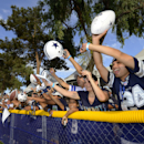Fans yell for autographs as the Dallas Cowboys leave the field at the end of practice during NFL football training camp, Friday, July 25, 2014, in Oxnard, Calif The Associated Press