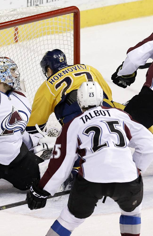 Nashville Predators forward Patric Hornqvist (27), of Sweden, falls into Colorado Avalanche goalie Semyon Varlamov (1), of Russia, as Hornqvist scores a goal in the second period of an NHL hockey game, Saturday, Jan. 18, 2014, in Nashville, Tenn. Also defending for the Avalanche are Maxime Talbot (25) and Nick Holden (2)