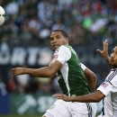 Portland Timbers Ryan Johnson (9) and Los Angeles Galaxy defender Sean Franklin (5) fight for possession in a Major League Soccer game at Jeld-Wen Field, Saturday, July 13, 2013 in Portland, Ore. (AP Photo/The Oregonian, Thomas Boyd)