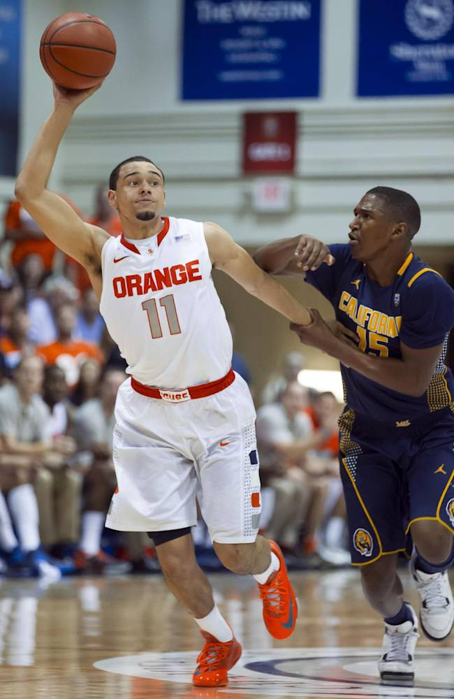 Syracuse guard Tyler Ennis (11) manages to steal the ball away from California guard Jordan Mathews (15) in the first half of an NCAA college basketball game at the Maui Invitational on Tuesday, Nov. 26, 2013, in Lahaina, Hawaii