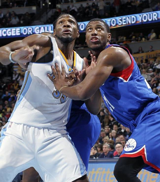 Philadelphia 76ers forward Thaddeus Young, right, battles for position for a rebound with Denver Nuggets forward Kenneth Faried in the third quarter of the Sixers' 114-102 victory in an NBA basketball game in Denver on Wednesday, Jan. 1, 2014